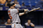 FILE - In this Aug. 7, 2018, file photo, Baltimore Orioles' Mark Trumbo swings for an RBI single against the Tampa Bay Rays during the sixth inning of a baseball game, in St. Petersburg, Fla. Sluggers Chris Davis and Mark Trumbo, along with starting pitchers Andrew Cashner and Alex Cobb, are among a handful of veterans sure to make the 25-man roster. (AP Photo/Chris O'Meara, File)