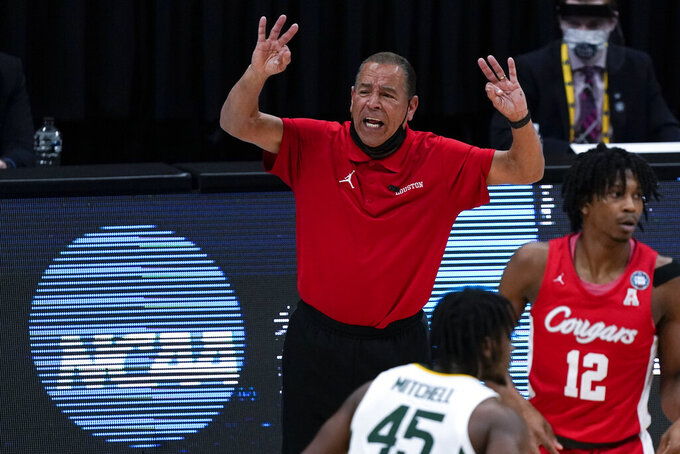 Houston head coach Kelvin Sampson reacts during the second half of a men's Final Four NCAA college basketball tournament semifinal game against Baylor, Saturday, April 3, 2021, at Lucas Oil Stadium in Indianapolis. (AP Photo/Michael Conroy)