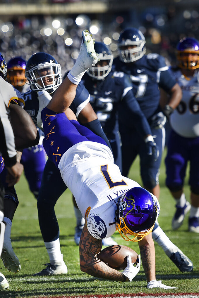 East Carolina running back Darius Pinnix Jr. (7) dives in for a touchdown during the first half of an NCAA college football game against Connecticut Saturday, Nov. 23, 2019, in East Hartford, Conn. (AP Photo/Stephen Dunn)
