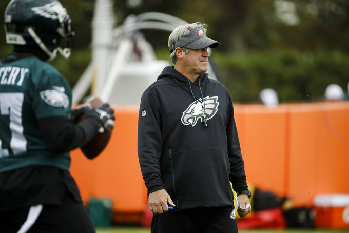 Philadelphia Eagles head coach Doug Pederson views practice at the NFL football team's training facility in Philadelphia, Thursday, Oct. 17, 2019. (AP Photo/Matt Rourke)