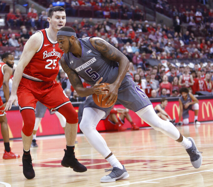 Northwestern's Dererk Pardon, right, drives to the basket against Ohio State's Kyle Young during the first half of an NCAA college basketball game Wednesday, Feb. 20, 2019, in Columbus, Ohio. (AP Photo/Jay LaPrete)