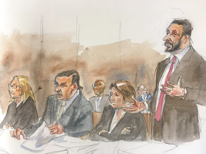 CORRECTS SKETCH ARTIST'S NAME TO AGGIE, NOT MAGGIE - In this courtroom sketch, Cesar Sayoc, second left, sits as his Attorney Ian H. Amelkin, right, speaks at federal court in New York on Monday, Aug. 5, 2019. Sayoc, a Florida amateur body builder who admitted sending inoperative pipe bombs to prominent Democrats and CNN, was sentenced to 20 years in prison Monday by a judge who said he concluded that the bombs purposely were not designed to explode. (Aggie Kenny via AP)