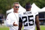 Jacksonville Jaguars head coach Urban Meyer, left, talks with defensive back Jarrod Wilson (25) during an NFL football practice, Saturday, Aug. 7, 2021, in Jacksonville, Fla. (AP Photo/John Raoux)