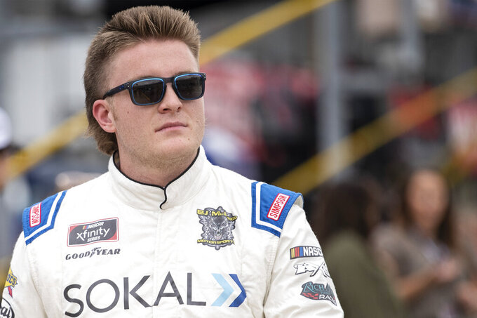 NASCAR Xfinity Series driver Stefan Parsons (78) walks down pit road prior to the NASCAR Xfinity auto racing race at the Charlotte Motor Speedway Saturday, Oct. 9, 2021, in Concord, N.C. (AP Photo/Matt Kelley)