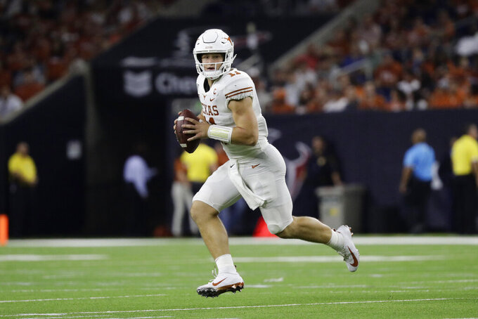 FILE - In this Sept. 14, 2019, file photo, Texas quarterback Sam Ehlinger (11) looks to throw against Rice during the second half of an NCAA college football game in Houston. While Oklahoma appears to have another serious Heisman contender with Big 12 newcomer and dual-threat graduate transfer Jalen Hurts, the Longhorns have one of the eight underclassmen starting quarterbacks in the league. Texas junior Sam Ehlinger is off to a record-setting pace that could also get him in that Heisman conversation. (AP Photo/Eric Gay, File)