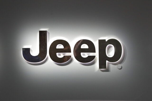 FILE - This Jan. 14, 2019 photo shows a Jeep logo at the North American International Auto Show in Detroit.  Fiat Chrysler is recalling almost 95,000 Jeep Cherokees worldwide, Thursday, June 18, 2020,  because a transmission problem can cause the small SUVs to lose power unexpectedly.  The recall covers certain Cherokees from the 2014 through 2017 model years and includes about 2,700 replacement parts.  (AP Photo/Paul Sancya)