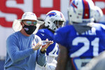 Buffalo Bills head coach Sean McDermott cheers on his players in a drill during an NFL football training camp in Orchard Park, N.Y., Sunday, Aug. 23, 2020. (James P. McCoy/The Buffalo News via AP, Pool)