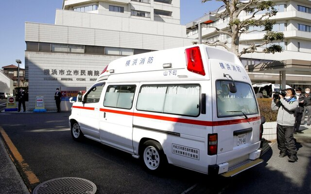 In this Feb. 5, 2020, photo, an ambulance carrying a passenger onboard cruise ship Diamond Princess arrives at a hospital in Yokohama, near Tokyo. Hospitals in Japan are increasingly turning away sick people in ambulances as the country braces for a surge in coronavirus infections. The Japanese Association for Acute Medicine and the Japanese Society for Emergency Medicine say emergency medicine has already collapsed with many hospitals refusing to treat people including those suffering strokes, heart attacks and external injuries. (Kyodo News via AP)(Sadayuki Goto/Kyodo News via AP)
