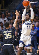 Villanova forward Saddiq Bey (41) takes a three point shot over Army forward Alex King (35) during the first half of an NCAA college basketball game Tuesday, Nov. 5, 2019, in Villanova, Pa. (AP Photo/Laurence Kesterson)
