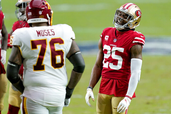 San Francisco 49ers cornerback Richard Sherman (25) laughs with Washington Football Team offensive tackle Morgan Moses (76) during the first half of an NFL football game, Sunday, Dec. 13, 2020, in Glendale, Ariz. (AP Photo/Ross D. Franklin)