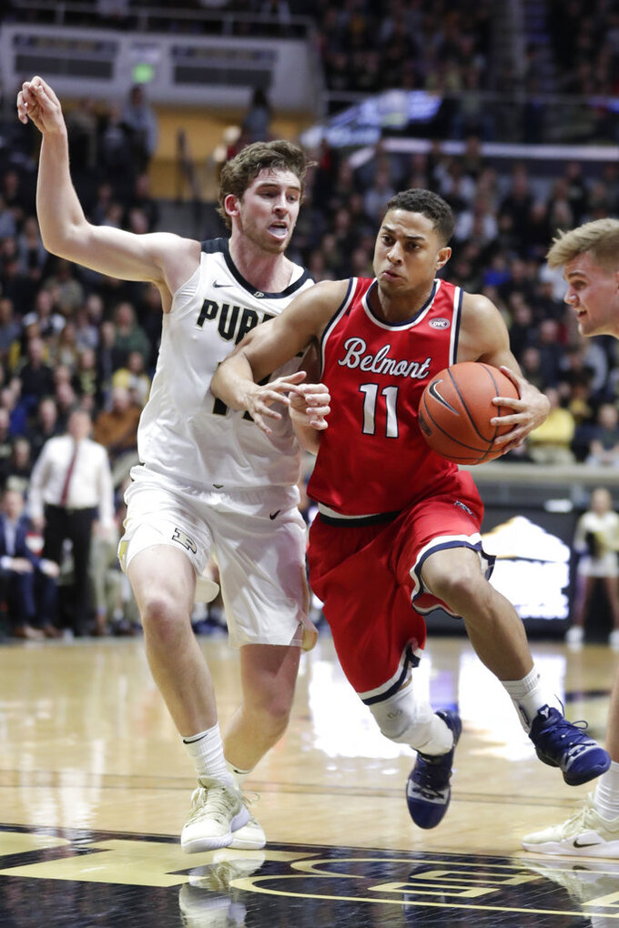 Belmont guard Kevin McClain (11) drives on Purdue guard Ryan Cline (14) during the first half of an NCAA college basketball game in West Lafayette, Ind., Saturday, Dec. 29, 2018. (AP Photo/Michael Conroy)