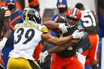 Cleveland Browns running back Nick Chubb (24) breaks a tackle from Pittsburgh Steelers free safety Minkah Fitzpatrick (39) and rushes for a 47-yard touchdown during the first half of an NFL football game, Sunday, Jan. 3, 2021, in Cleveland. (AP Photo/Ron Schwane)