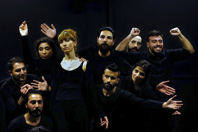 In this Friday, Feb. 8, 2019 photo, a team of Syrian actors take part in a playback theater at the end of a three-month training session, in Beirut, Lebanon. The aim of the training, that was held for the first time in a Beirut theater, is to raise awareness of conflict, help in reconciliation and initiate dialogue between rival groups. (AP Photo/Bilal Hussein)
