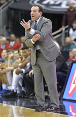 Duke head coach Mike Krzyzewski argues a call during the second half of the team's NCAA college basketball game against Louisville in Louisville, Ky., Tuesday, Feb. 12, 2019. Duke won 71-69. (AP Photo/Timothy D. Easley)