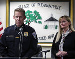Pleasantville Police Chief Erik Grutzner, left, and Pleasantville School Superintendent Mary Fox-Alter, speak during a news conference after two adults and two children were found dead in their home in Pleasantville, N.Y., Thursday Dec. 5, 2019. (Frank Becerra Jr/The Journal News via AP)