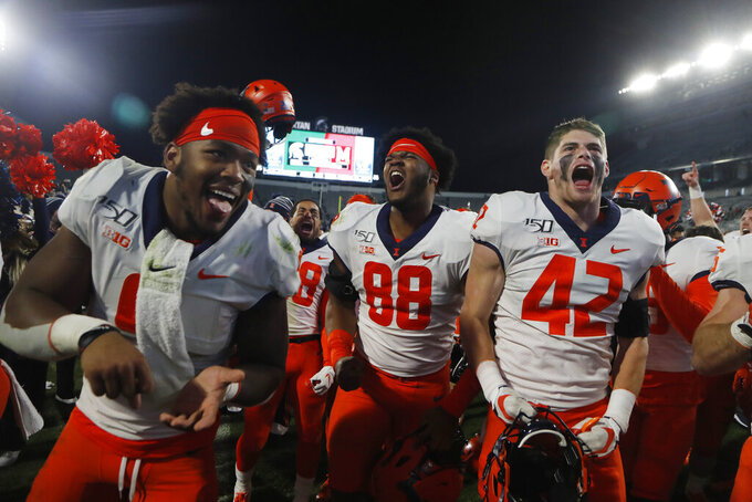 Illinois defensive lineman Keith Randolph Jr. (88), defensive back Michael Marchese (42) and others celebrate their win over Michigan State in an NCAA college football game, Saturday, Nov. 9, 2019, in East Lansing, Mich. (AP Photo/Carlos Osorio)