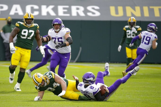 Green Bay Packers' Dean Lowry sacks Minnesota Vikings' Kirk Cousins during the first half of an NFL football game Sunday, Nov. 1, 2020, in Green Bay, Wis. (AP Photo/Mike Roemer)