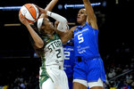 Seattle Storm guard Jordin Canada (21) shoots as Connecticut Sun guard Jasmine Thomas (5) defends during the first half of the Commissioner's Cup WNBA basketball game Thursday, Aug. 12, 2021, in Phoenix. (AP Photo/Matt York)