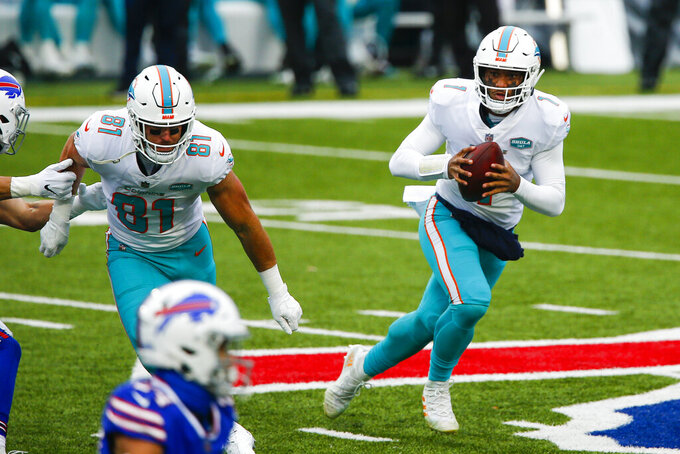 Miami Dolphins quarterback Tua Tagovailoa (1) looks to pass on the run during the first half of an NFL football game against the Buffalo Bills, Sunday, Jan. 3, 2021, in Orchard Park, N.Y. (AP Photo/John Munson)
