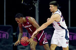 Liberty's Kyle Rode, right, knocks the ball away from South Carolina's T.J. Moss (1) during the second half of an NCAA college basketball game Saturday, Nov. 28, 2020, at the T-Mobile Center in Kansas City, Mo. (AP Photo/Charlie Riedel)
