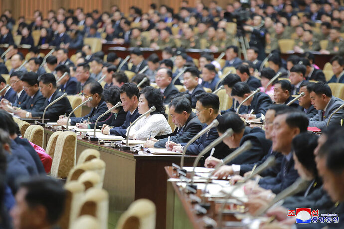In this photo provided by the North Korean government, members of the Supreme People's Assembly attend a meeting in Pyongyang, North Korea Sunday, Jan. 17, 2021. North Korea's rubber-stamp parliament has passed decisions made by a major ruling party meeting where leader Kim Jong Un vowed to bolster his nuclear deterrent and established plans to salvage a dismal economy. Independent journalists were not given access to cover the event depicted in this image distributed by the North Korean government. The content of this image is as provided and cannot be independently verified. Korean language watermark on image as provided by source reads: