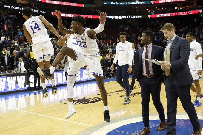 Seton Hall guard Jared Rhoden (14), guard Shavar Reynolds (33) and guard Myles Cale (22) react after an NCAA college basketball game against Marquette, Wednesday, March 6, 2019, in Newark, N.J. Seton Hall won 73-64. (AP Photo/Julio Cortez)
