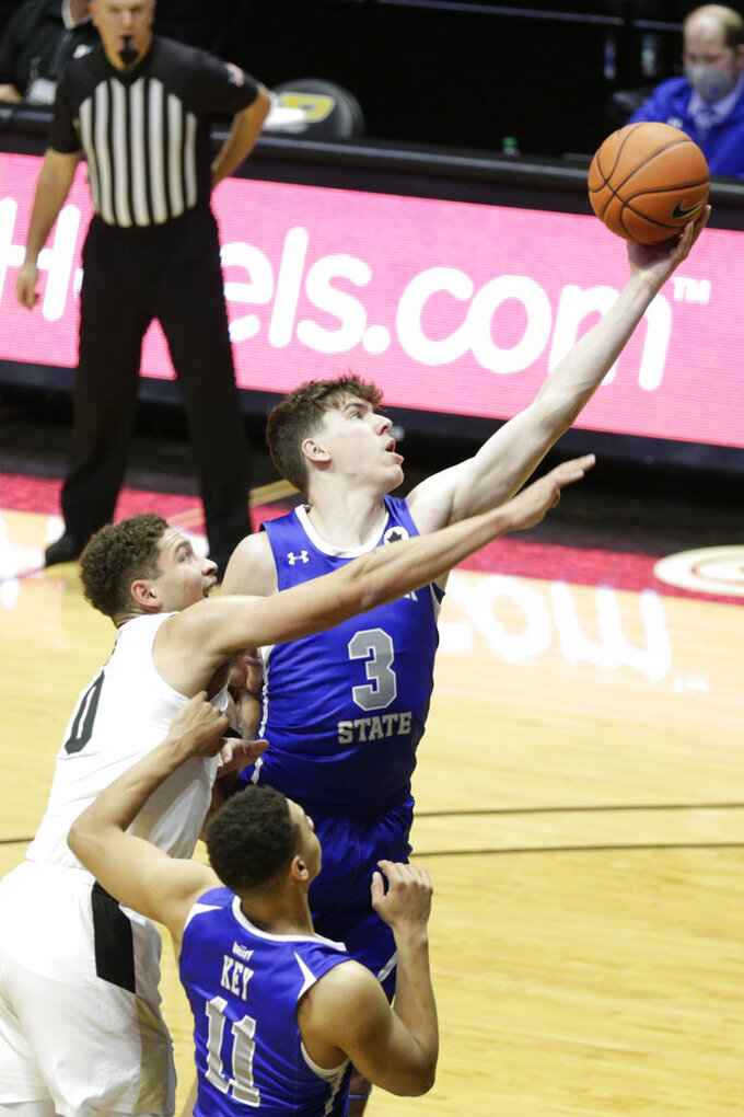 Indiana State's forward Jake LaRavia (3) reaches out for the rebound against Purdue forward Mason Gillis (0) during the first half of an NCAA men's basketball game, Saturday, Dec. 12, 2020, in West Lafayette, Ind. (Nikos Frazier/Journal & Courier via AP)