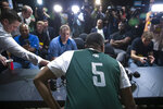 Michigan State guard Cassius Winston (5) arrives to takes his seat for an NCAA men's college basketball individual news conference in Washington, Saturday, March 30, 2019. Michigan State plays Duke in the East Regional final game on Sunday. (AP Photo/Alex Brandon)