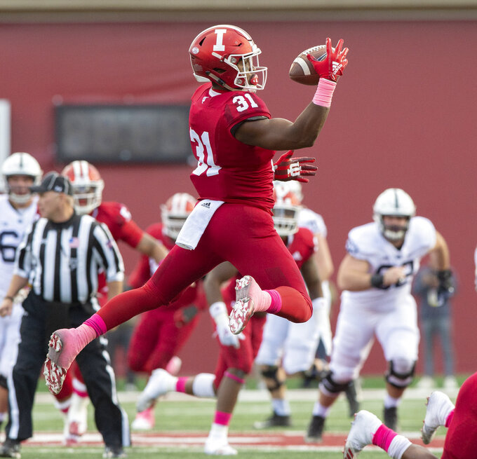 Indiana defensive back Bryant Fitzgerald (31) grabs hold of a tipped ball for an interception during the first half of an NCAA college football game against Penn State Saturday, Oct. 20, 2018, in Bloomington, Ind. (AP Photo/Doug McSchooler)