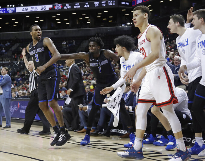 Saint Louis' Javon Bess (3) celebrates with teammates after making a 3-point basket as Davidson's Kellan Grady (31) reacts during the second half of an NCAA college basketball game in the semifinal round of the Atlantic 10 men's tournament Saturday, March 16, 2019, in New York. Saint Louis won 67-44. (AP Photo/Frank Franklin II)