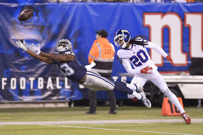 Dallas Cowboys wide receiver Michael Gallup (13) stretches out but can't make the catch against New York Giants cornerback Janoris Jenkins (20) during the second quarter of an NFL football game, Monday, Nov. 4, 2019, in East Rutherford, N.J. (AP Photo/Bill Kostroun)