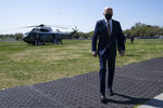 President Joe Biden walks over to speak with reporters on the Ellipse on the National Mall after spending the weekend at Camp David, Monday, April 5, 2021, in Washington. (AP Photo/Evan Vucci)