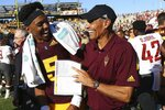 Arizona State quarterback Jayden Daniels (5) celebrates with head coach Herm Edwards, right, after an NCAA college football game win over Washington State, Saturday, Oct. 12, 2019, in Tempe, Ariz. (AP Photo/Ross D. Franklin)