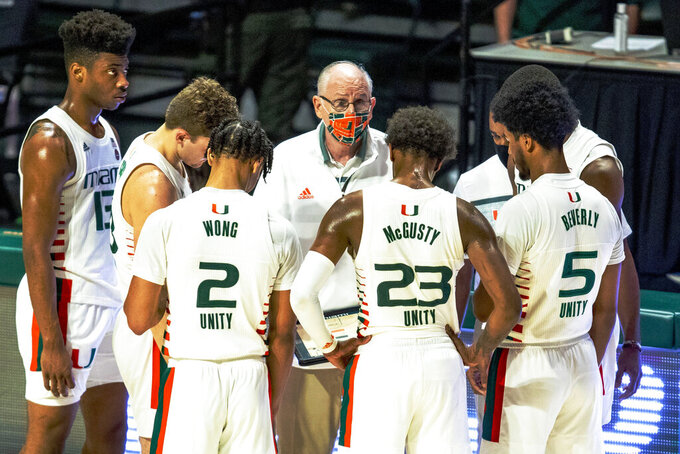 Miami head coach Jim Larranaga speaks to his players during a timeout in the first half of an NCAA college basketball game in Coral Gables, Fla., on Saturday, Jan. 2, 2021. (Daniel A. Varela/Miami Herald via AP)