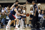 San Diego guard Braun Hartfield, center, looks to pass as Gonzaga forwards Corey Kispert, front left, and Filip Petrusev defend during the first half of an NCAA college basketball game Thursday, Jan. 9, 2020, in San Diego. (AP Photo/Gregory Bull)