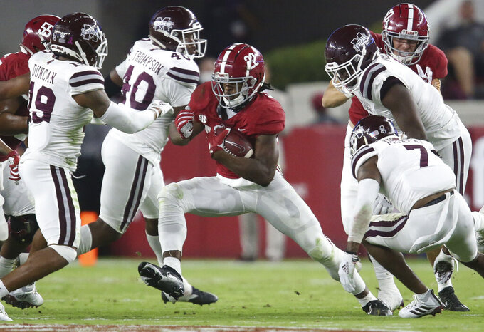 Alabama running back Najee Harris (22) cuts back as he runs in the middle of the Mississippi State defense during an NCAA college football game in Tuscaloosa, Ala., Saturday, Oct. 31, 2020. (Gary Cosby Jr./The Tuscaloosa News via AP)