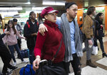 Luz Aurora Vidal and her son, Martín Batalla Vidal, line up to take a bus to Washington, Monday, Nov. 11, 2019, in New York. Martin Batalia Vidal is a lead plaintiff in one of the cases to preserve the Obama-era program known as Deferred Action for Childhood Arrivals and has seen his name splashed in legal documents since 2016, when he first sued in New York. His case will be heard at the Supreme Court beginning Tuesday. (AP Photo/Mark Lennihan)