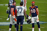 Denver Broncos tight end Jake Butt (80) and offensive guard Graham Glasgow (61) greet Tennessee Titans offensive tackle Taylor Lewan (77) after an NFL football game, Monday, Sept. 14, 2020, in Denver. The Titans win 16-14. (AP Photo/Jack Dempsey)