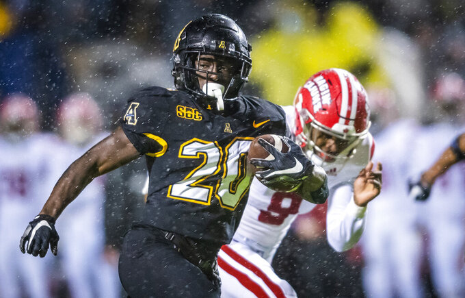 Appalachian State running back Nate Noel (20) runs the ball on his way to a touchdown against Louisiana during an NCAA college football game Friday, Dec. 4, 2020, in Boone, N.C. (Andrew Dye/The Winston-Salem Journal via AP)