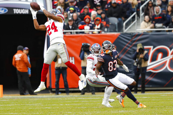 New York Giants cornerback Julian Love (24) intercepts a pass intended for Chicago Bears wide receiver Javon Wims (83) during the second half of an NFL football game in Chicago, Sunday, Nov. 24, 2019. (AP Photo/Charles Rex Arbogast)