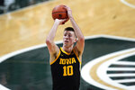 Iowa guard Joe Wieskamp shoots against Michigan State in the first half of an NCAA college basketball game in East Lansing, Mich., Saturday, Feb. 13, 2021. (AP Photo/Paul Sancya)