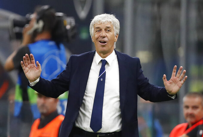 FILE - In this  Tuesday, Oct. 1, 2019 file photo, Atalanta coach Gian Piero Gasperini gives instructions during the Champions League group C soccer match between Atalanta and Shakhtar Donetsk at the San Siro stadium in Milan, Italy. Gasperini says he had the coronavirus and was concerned for his life mid-March. Gasperini tells the Gazzetta dello Sport that he started feeling sick on March 9, a day before Atalanta played at Valencia in the second leg of the Champions League round of 16. (AP Photo/Antonio Calanni, File)