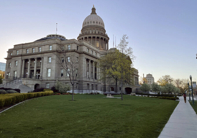 The Idaho Statehouse is seen at sunrise on April 20, 2021, in Boise, Idaho. Mainstream and far-right Republicans are battling for control of the party and the state in the deeply conservative state. (AP Photo/Keith Ridler)