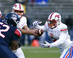 SMU quarterback Ben Hicks (8) hands off to running back Ke'Mon Freeman (2) in the second half of an NCAA college football game against Connecticut, Saturday, Nov. 10, 2018, in East Hartford, Conn.(AP Photo/Stephen Dunn)
