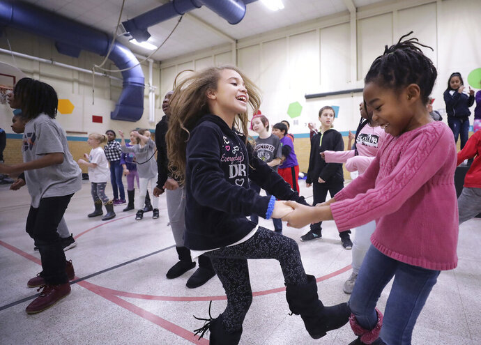 In a file photo from Thursday, Jan. 24, 2019, Mendota Elementary School third graders Aurela Lueders, left, and Rachel Mambula rehearse their roles for production of the Disney musical