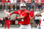 Ohio State quarterback Justin Fields throws a pass against Cincinnati during the first half of an NCAA college football game Saturday, Sept. 7, 2019, in Columbus, Ohio. (AP Photo/Jay LaPrete)