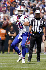Buffalo Bills quarterback Mitchell Trubisky looks to pass during the first half of an NFL preseason football game against the Chicago Bears Saturday, Aug. 21, 2021, in Chicago. (AP Photo/David Banks)