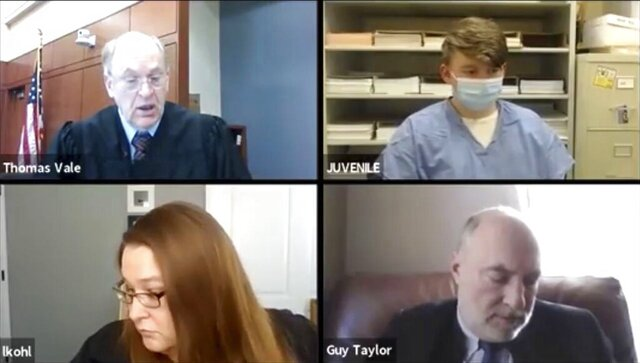 Logan T. Kruckenberg-Anderson, 16, top right, appears by video conference in Green County, Wis. Circuit Court on Tuesday, Jan. 12, 2021 with Circuit Judge Thomas Vale, top left, Assistant District Attorney Laura Kohl and assistant state public defender Guy Taylor. Prosecutors say Kruckenberg-Anderson has admitted fatally shooting his newborn daughter and leaving her body inside a fallen tree in the woods in southern Wisconsin. Logan Kruckenburg-Anderson is charged as an adult with first-degree intentional homicide and hiding a corpse. (Wisconsin Circuit Court Access/Wisconsin State Journal via AP)