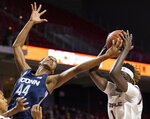 Connecticut guard Aubrey Griffin (44) and Temple forward Lena Niang (1) reach for a rebound during the first half of an NCAA college basketball game Sunday, Nov. 17, 2019, in Philadelphia. (AP Photo/Laurence Kesterson)