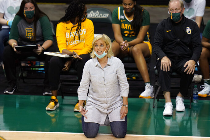 """Baylor head coach Kim Mulkey is shown during the second half of an NCAA women's college basketball game against South Florida Tuesday, Dec. 1, 2020, in Tampa, Fla. No. 6 Baylor canceled its much-anticipated home game Thursday night against No. 3 UConn after Lady Bears coach Kim Mulkey tested positive for COVID-19. """"I immediately self-quarantined and did not re-join the team when our staff and players came back from our holiday break on December 28,"""" Mulkey said in a statement Tuesday, Jan. 5, 2021. (AP Photo/Chris O'Meara)"""